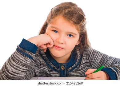 An adorable blonde blue-eyed girl holding a crayon and resting her head on her hand looking bored and annoyed