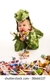 Adorable boy in crocodile Halloween costume playing trick or treat and asking for sweets.