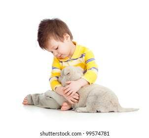 adorable boy hugging and playing with a puppy