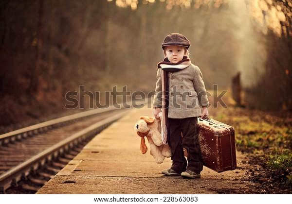 adorable-boy-on-railway-station-600w-228