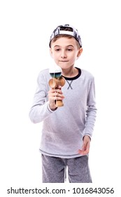 Adorable boy playing kendama isolated on white backround