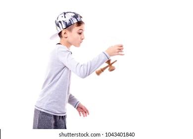 Adorable boy playing kendama isolated on white backround
