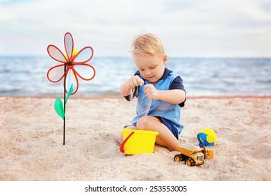 Adorable boy playing on the sea