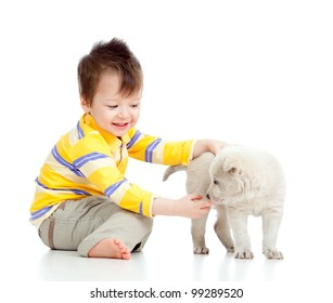 adorable boy playing with a puppy