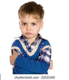 Adorable boy upset isolated over white background