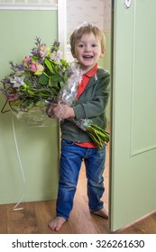 Adorable child bringing a bouquet of flowers