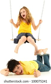 Adorable child couple portrait, girl kicks boy on ground while swinging.  Over white background.