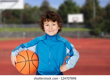 Adorable child playing the basketball in the basket field