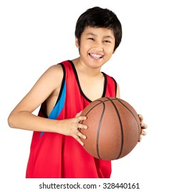 Adorable child playing the basketball, Isolated over white