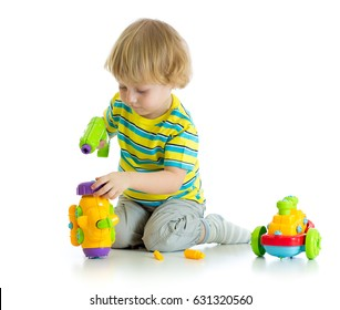 An adorable child playing with educational isolated on white background.