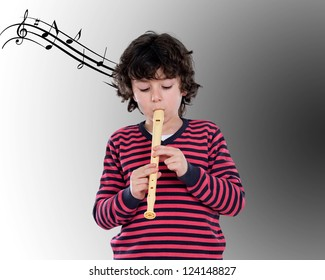 Adorable child playing flute with a score background