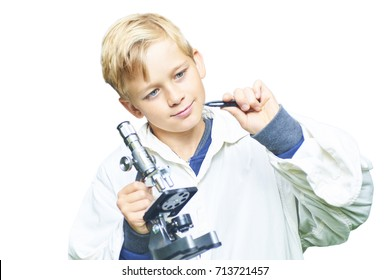 Adorable child school blond boy prepares to examine insect under the microscope. Isolated on white background. Concept of young scientist