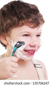 Adorable child shaving isolated on white background