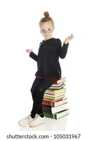 "An adorable child ""teacher/librarian"" sitting on a tall stack of books gesturing ""I don't know.""  On a white background."