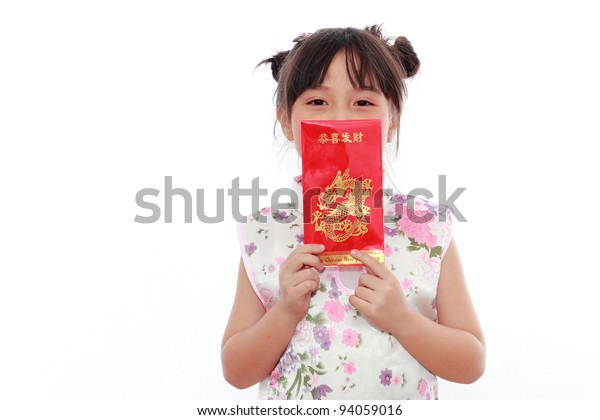 Adorable Chinese little girl holding red bag(hongbao or angbao) for happy chinese new year
