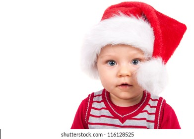 Adorable christmas child in a red hat isolated