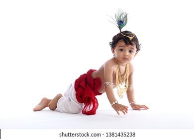 Adorable crawling baby wearing Krishna costume