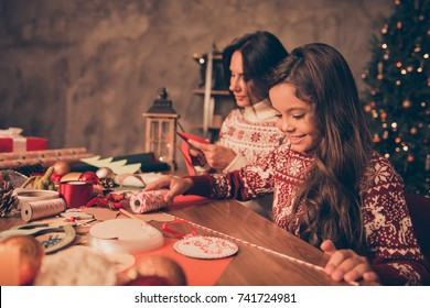 Adorable cute girl with mom doing handcraft activity, enjoying, desktop is full of materials. Happiness, upbringing, childhood, friendship, leisure, hobby, traditions x mas noel concept