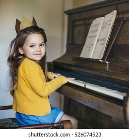 Adorable Cute Girl Playing Piano Concept