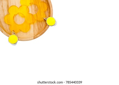 Adorable earrings on wood tray isolated white background