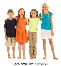 Adorable elementary aged children stand together. Studio shot on white background.