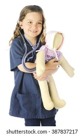 """An adorable elementary """"nurse"""" in blue scrubs listening to her doll's heart.  On a white background."""