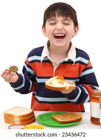 Adorable five year old boy making peanut butter and jelly sandwich.