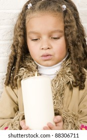 Adorable girl with candle