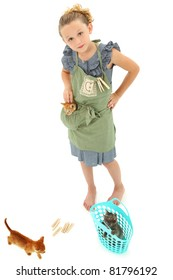 Adorable Girl Child in Apron playing house homemaker with kittens.  Retro dress and apron over white background.