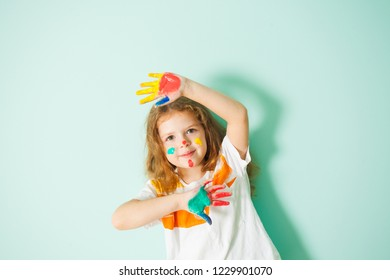 Adorable girl with colorful dots on her face