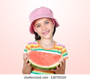 Adorable girl eating watermelon a over pink background