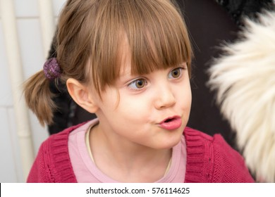Adorable Girl With Pigtails And Big Eyes