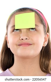 Adorable girl with post-it in her front isolated over white