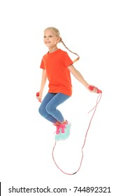 Adorable girl skipping rope, isolated on white