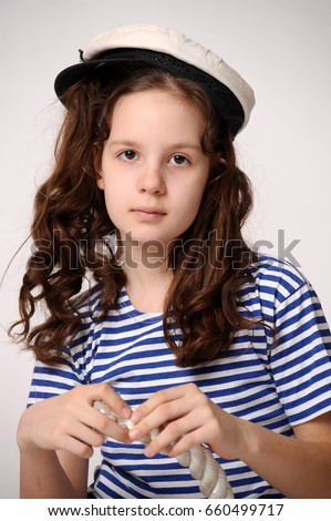 Adorable Girl Wearing Sea Captains Cap Stock Photo (Edit Now