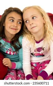 Adorable girls portrait looking at each other