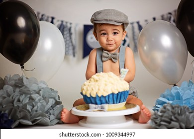 Adorable happy baby boy in a bright room. The baby smiling looking at camera. Retro style