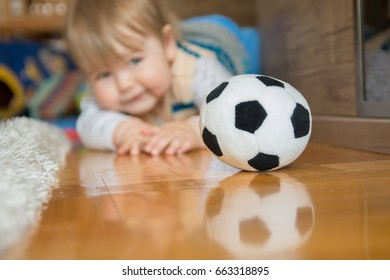 Adorable and happy baby boy child playing and smiling