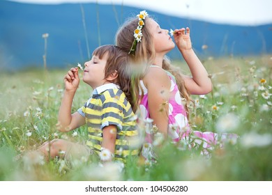 Adorable happy kids outdoors on summer day