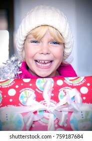 Adorable happy little girl with the Christmas gift