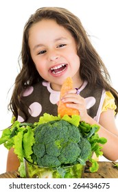 Adorable healthy little girl holding a carrot isolated on white