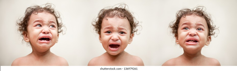Adorable Indian baby crying in different position over light gray background