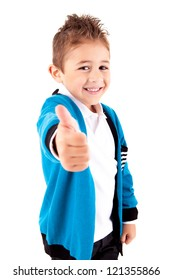 Adorable kid doing thumbs up  over white background