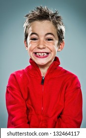Adorable Kid with Funny Expression over a Grey Background