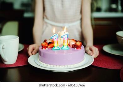 Adorable kid girl in elegant dress  with birthday cake
