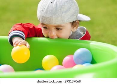 Adorable kid playing and biting playground