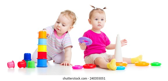 Adorable kids playing with colorful towers isolated