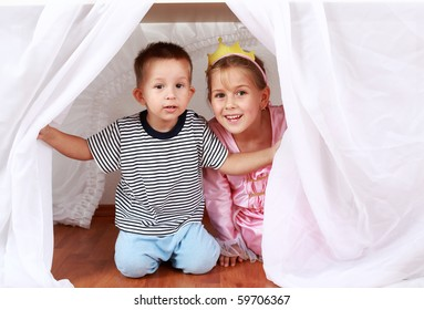 Adorable kids playing hide-and-seek at home