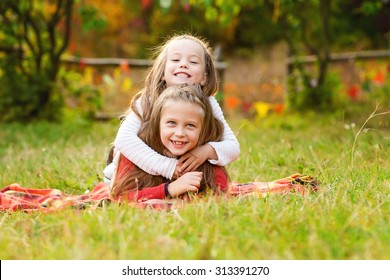 Adorable kids playing in the park. Autumn concept