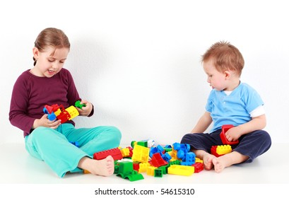 Adorable kids playing together with blocks
